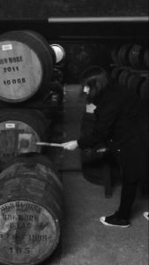 Lisa flogging a bung at Bowmore Distillery