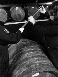Lisa using a valinch at Lagavulin Distillery